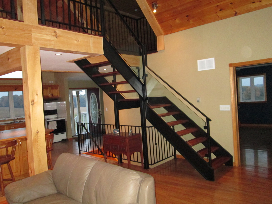Iron stairs with glass railings