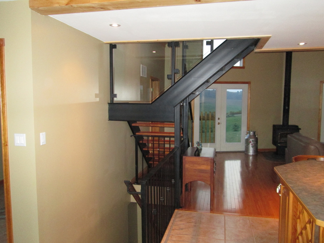 Iron stairs with glass railing